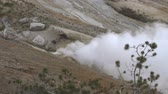 извержение : Slow motion steaming fumarole in Yellowstones Norris Geyser Basin Стоковые видеозаписи