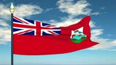 bermudas : Flag Of Bermuda on the background of the sky and flying clouds.