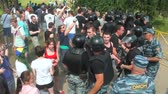 riot control : Police disperse people at the rally Stock Footage