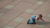 on all fours : Baby crawling on all fours on the granite pavement