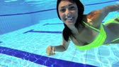 happy : Gorgeous female model swimming underwater