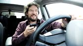 mobile phone : Man driving in a dangerous way texting with cell phone