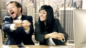 Business couple in love having fun dancing in office slow motion