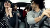 Happy group of people enjoying music in car