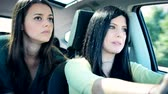 ököl : Unhappy female friends getting into fight while traveling in car Stock mozgókép