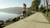 meditation : Happy young woman running sporty in front of lake in summer