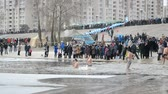 bem aventurado : Epiphany near Svjato-Pokrovskiy Cathedral on January 19,2014 in Kiev,Ukraine.People plunging into ice-cold water as it helps body became resilient to illness. Epiphany known since 988 AD. Stock Footage