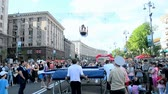 conceptual : Sport gymnastics show on the central city street Kreshatik during Kyivs city Day in Kiev, Ukraine on May 25, 2013. Stock Footage