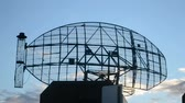 monitoring : military radar station, modern rotated satellite antenna on blue sky