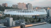 olympiáda : KIEV - MAY 18: National Complex Olympiysky with UEFA Champions League Final Symbols on May 18, 2018 in Kiev, Ukraine . FC Real Madrid and FC Liverpool Final game take place on May 26, 2018. Dostupné videozáznamy