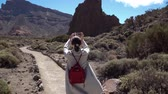 conquering : Walking with a phone and a selfie in the Park of the volcano Teide on the Canary island of. Spain. The Teide volcano