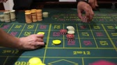 gaming chips : table game in a casino and the dealers hand the dealer chips. Full HD