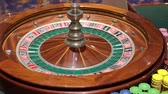 casino chips : Roulette table and croupiers hand. Full HD Stock Footage