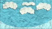 şekil : White Clouds Blue Sky Made Of Clay In Stop Motion