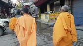 orar : Monks with Orange Robes Walking in Street India