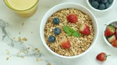 natural yogurt : Breakfast with muesli and berries Stock Footage