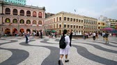 kultur : People walking around Senado Square in Macau