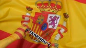 rozdělit : Catalan hands put the card - referendum on the flag of Spain