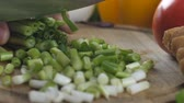 couve flor : Man s hands chopping the green onion into small pieces Vídeos