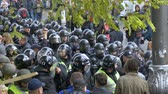 troops : KYIV, UKRAINE - OCT 17, 2017: Detachment of policemen in helmets is preparing to disperse the crowd.