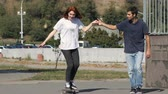 morning glory : Guy teaches a girl how to ride a skateboard