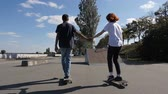 morning glory : Lovers skating and holding hands. Stock Footage