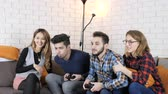 humorous : Multinational company sit on the couch, boys playing console 50 fps