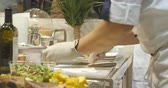 chef uniform : Cook in white gloves notes on a sheet of paper orders Stock Footage