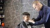 nape : Barber in black gloves gently shaves the childs nape and whiskey 60 fps