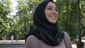 islamite : Young happy muslim girl in hijab is smiling and going to university in daytime in summer, religious concept, studying concept