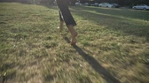 Silhouette of young extraordinary happy bold girl is running on lawn in park in daylight, in summer, heathy lifestyle Wideo