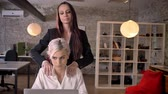 harassment : Young lesbian massaging her female colleague in modern office, woman flirting with woman