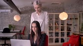 luxúria : Young blonde lesbian massaging woman in modern office during working, woman flirting with woman, seductive and attractive