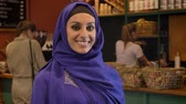islamite : Portrait of young muslim woman in hijab standing in cafe and smiling at camera, charming lady with pierced nose