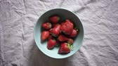 cânhamo : Close footage of different hands putting strawberries in bowl Stock Footage