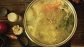 leeks : A simmering pot of chicken and beef broth