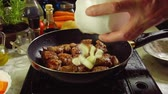 hearty : Preparing Irish stew: beef, potatoes, carrots and herbs. Traditional St. Patricks day dish