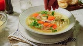Serving the chicken noodle soup Stock Footage
