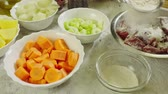 Ingredients for preparing Irish stew: beef, potatoes, carrots and herbs. Traditional St. Patricks day dish Stock Footage