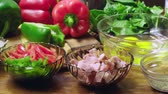 Ingredients for preparing frittata - eggs, parmesan, red pepper, green pepper and onion on wooden table. Italian cuisine