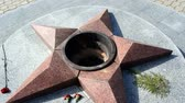 ignite : Burning of eternal fire. Five-pointed star made of granite memorial to the memory of killed soldiers.