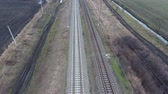 sleepers : Railway. The span over the railway tracks. Rails and railway sleepers, high-voltage electric power line