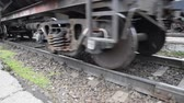 axle : Movement of a freight train. Tanks on rails. Wheels of the train.