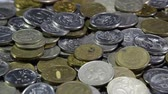debts : A lot of coins and cents rubles. Throwing coins into a common heap. Russian rubles