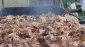 dana eti : Frying pork on a skewer over a brazier. Turning meat over coals. Appetizing shish kebab. Delicious barbecue.