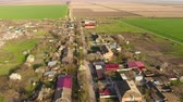 green area : Top view of the village. One can see the roofs of the houses and gardens. Road the village. Village birds-eye view.