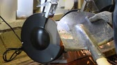 механик : Sharpening a shovel on a grinding machine. Electric sharpened.