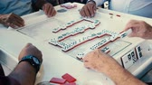 immigrants : High definition close up video of elderly individuals playing the popular domino game at the historic Domino Park in Little Havana in Miami.