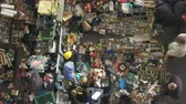антиквариат : Els Encants flea market in Barcelona. Jumble sale to hunt for vintage and secondhand treasures, recommended tourist visit. Smooth camera movement: Tracking Shot left. Стоковые видеозаписи