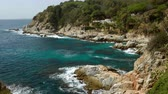 girona : Seascape of the COSTA BRAVA in Catalonia, Spain. View of cliff over the sea, municipality of LLoret province of Girona, with a public bar in an idyllic setting.
